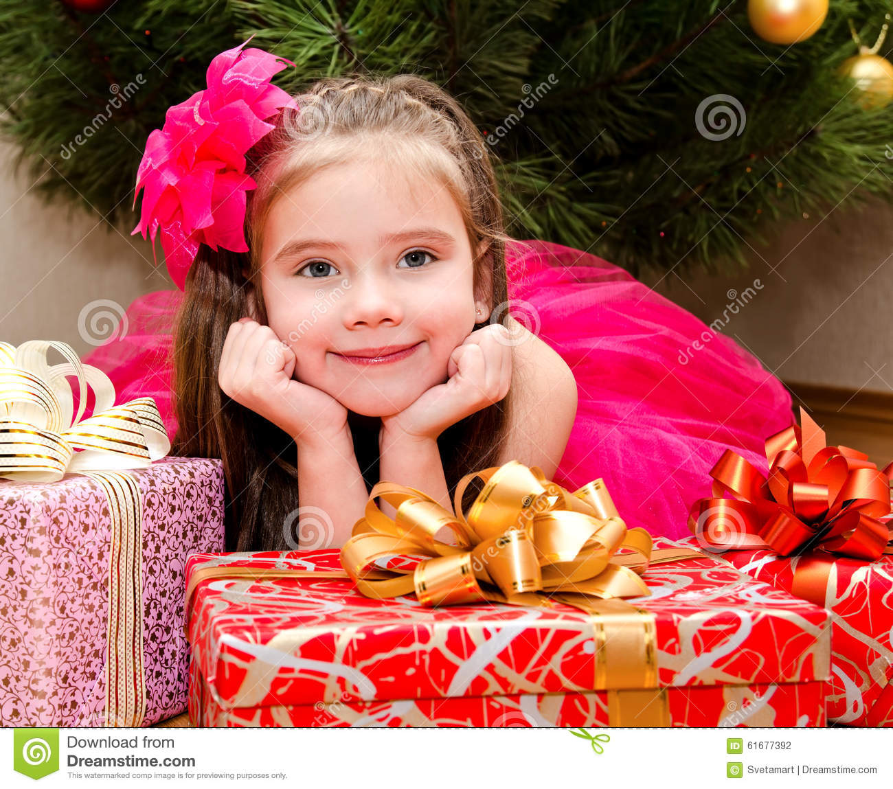 Little Girl Christmas Tree: Little Girl With Gift Boxes Near Christmas Tree Stock