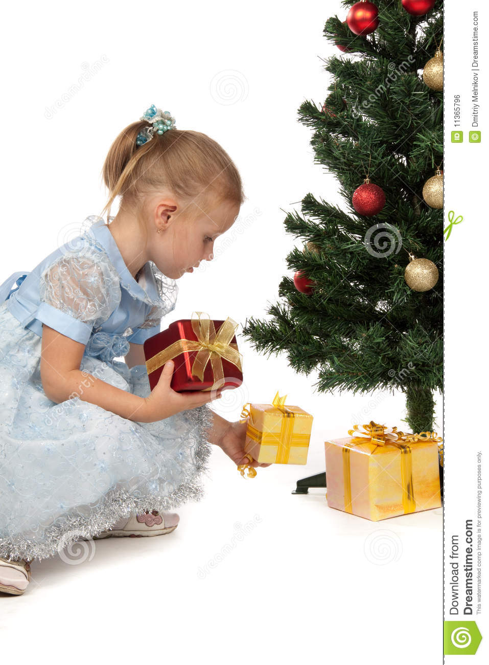 Little Girl With Gifts Near A Christmas Tree Stock Photo ...