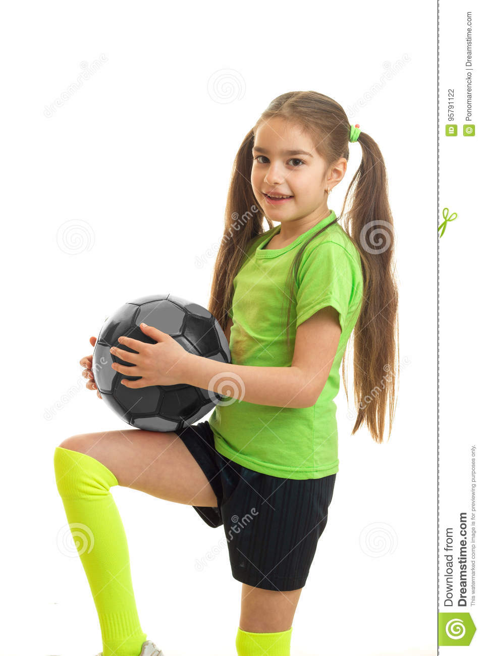 c78b702da Little Girl In Green Uniform Playing Soccer With Ball Stock Photo ...