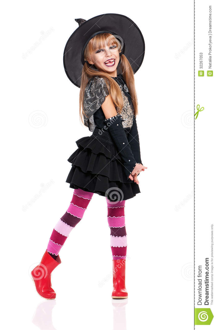 Portrait of little girl in black hat isolated on white background.