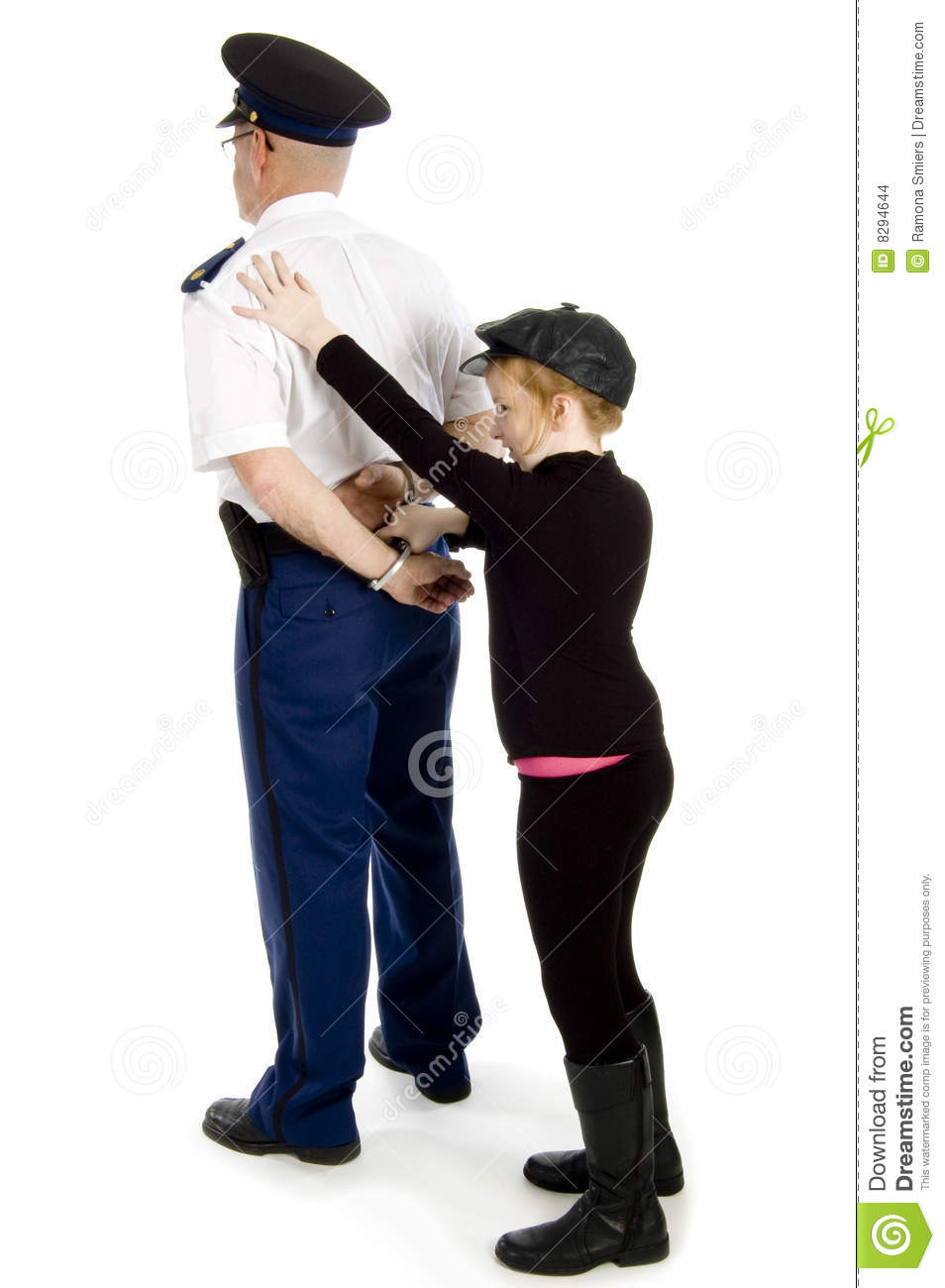 Little Girl Is Handcuffing A Police Officer Stock Images