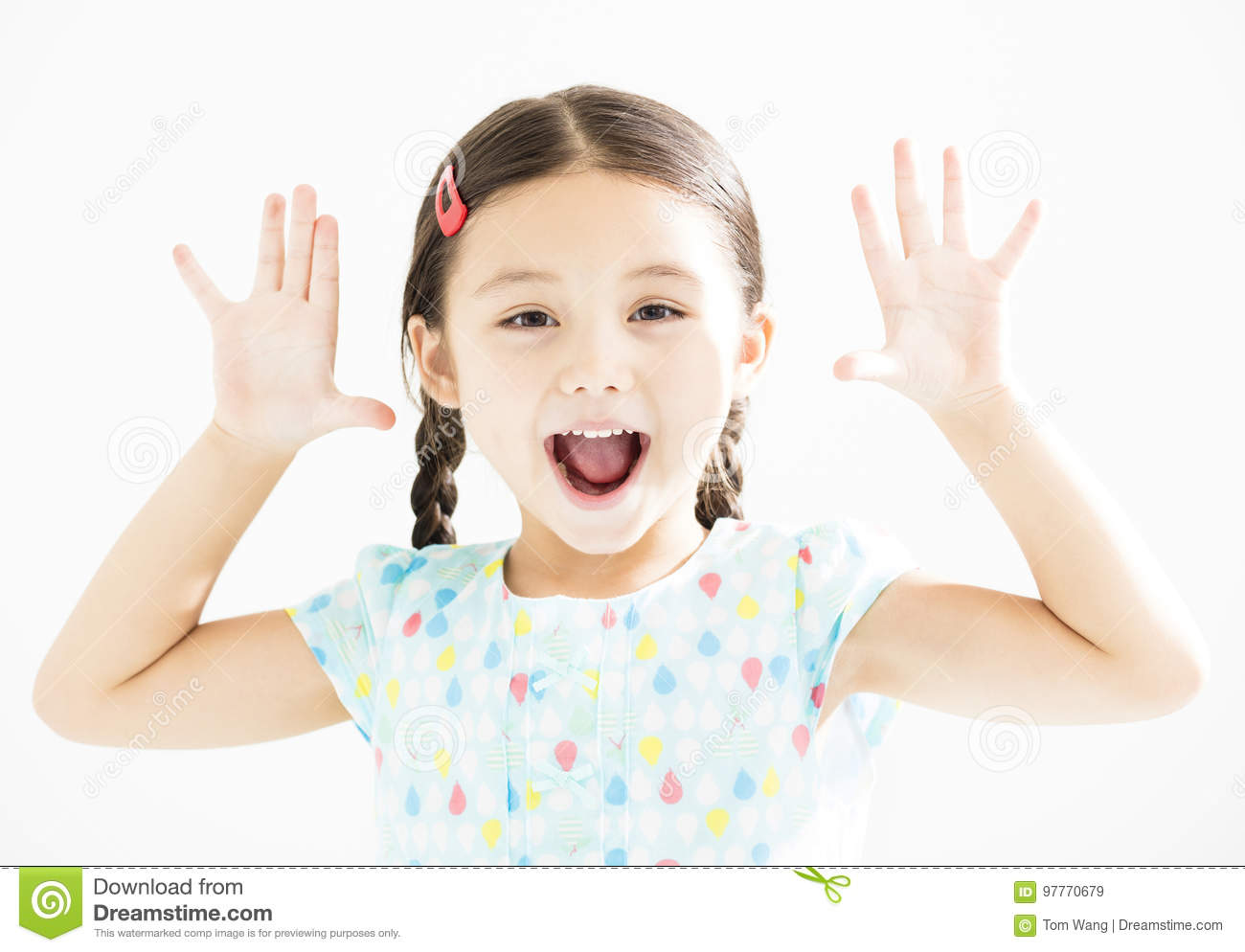 Little girl with hands up