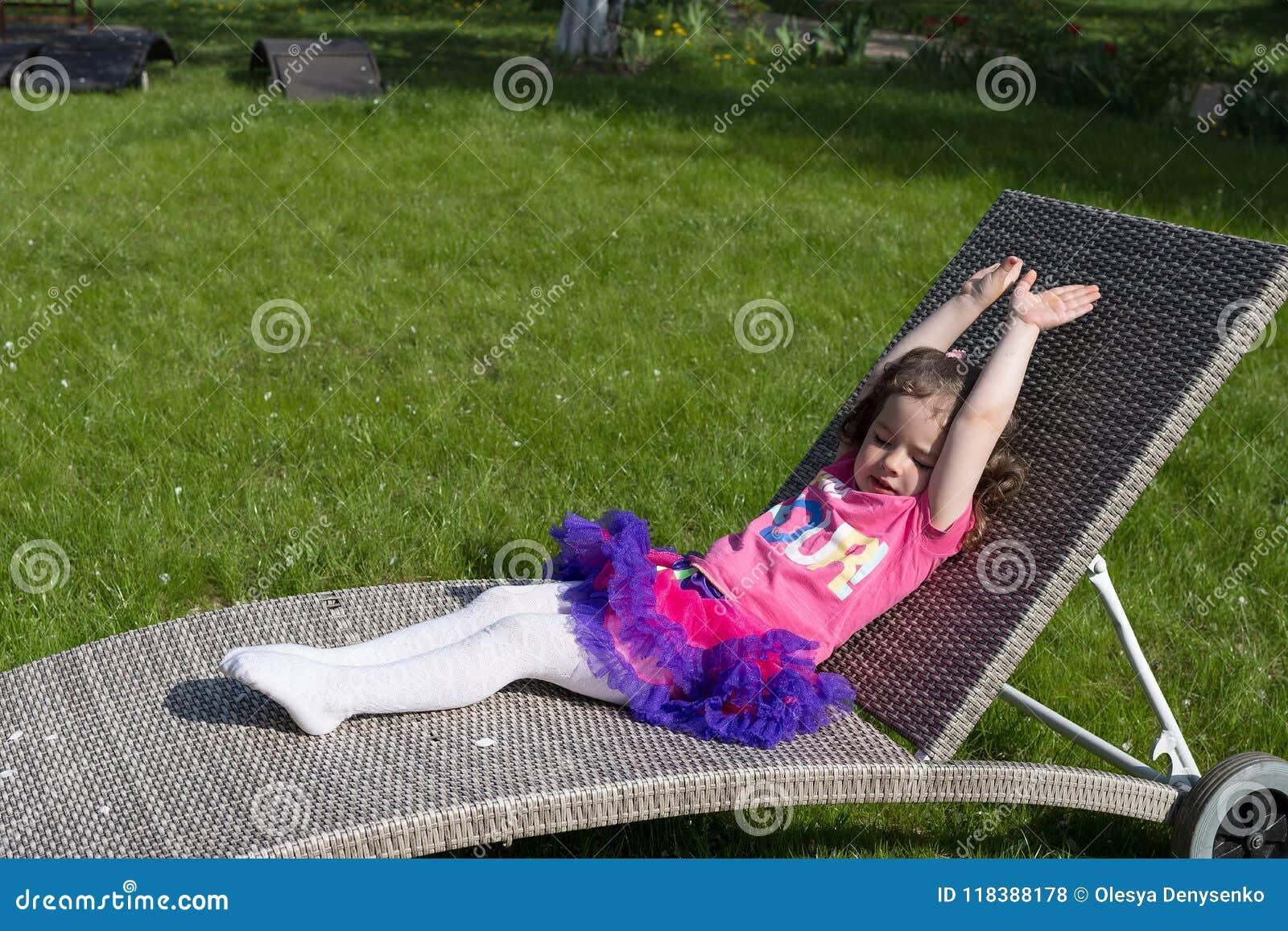 Little girl has a sunbath