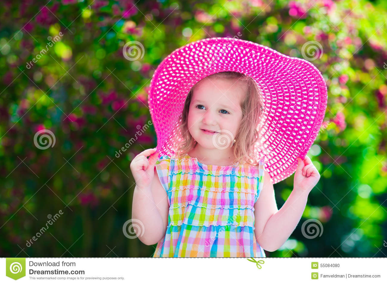 Little Girl In A Hat In Blooming Summer Garden Stock Photo Image