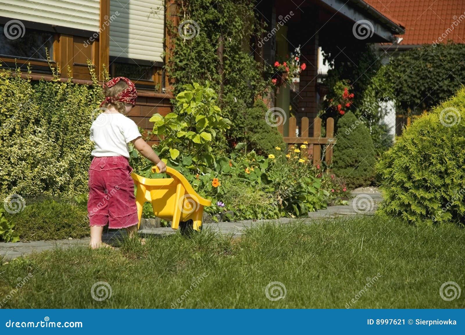 Little girl having fun in garden