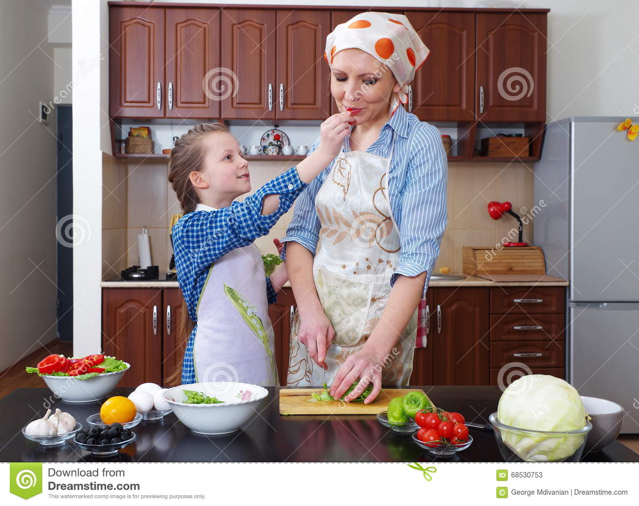 Little Girl Is Having Fun With Her Mother At Kitchen Stock Image Image 68530753
