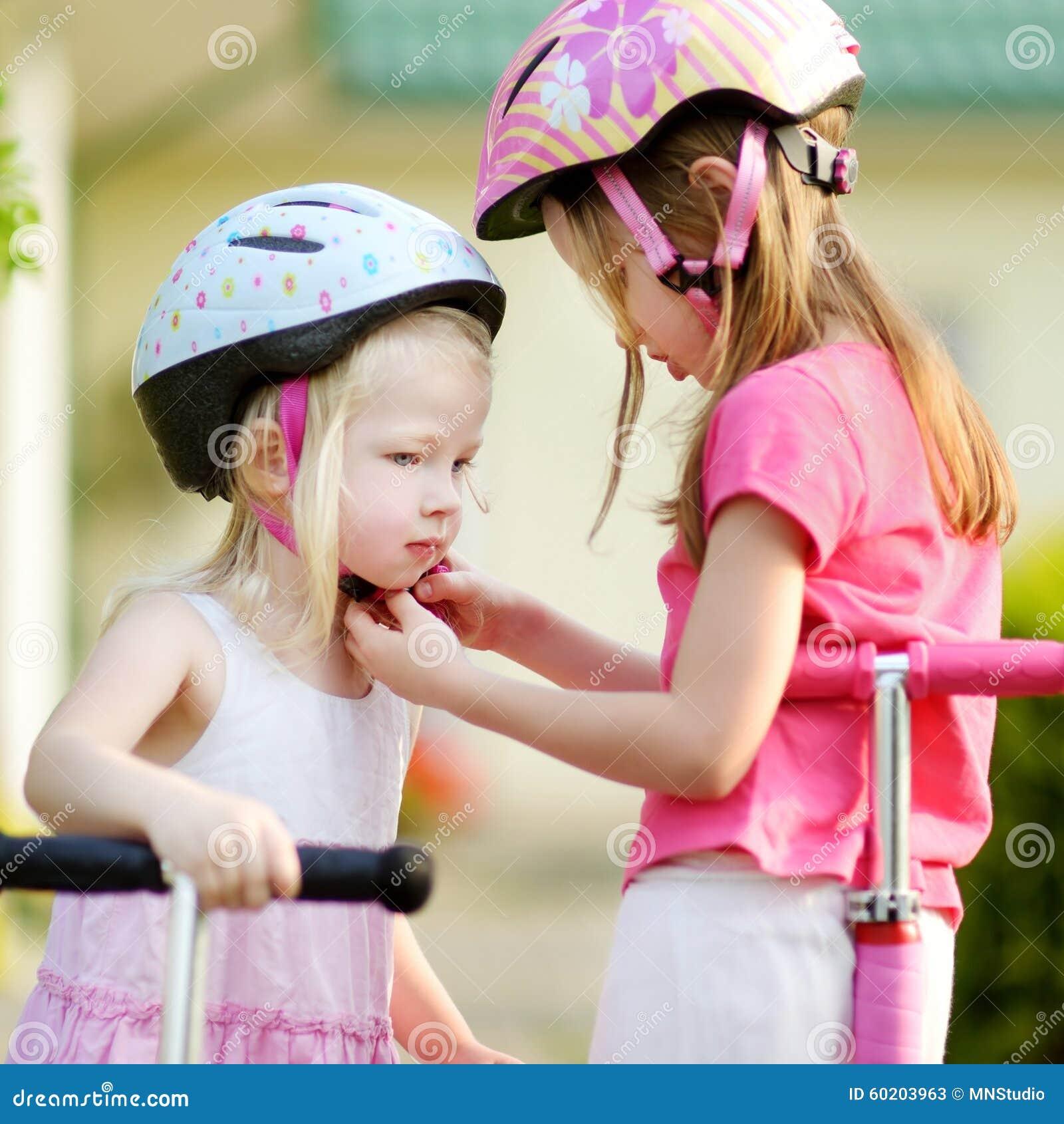 little girl helping her sister to put a helmet on stock Surfer Girl Silhouette free clipart surfer girl