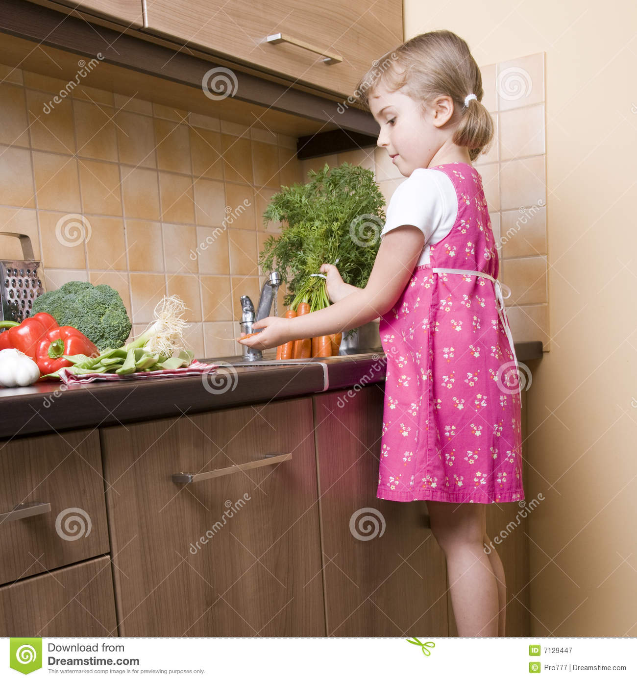 Little Girl Helping In Kitchen Royalty Free Stock