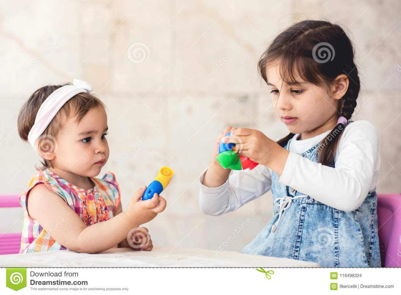Playing with sister-25677