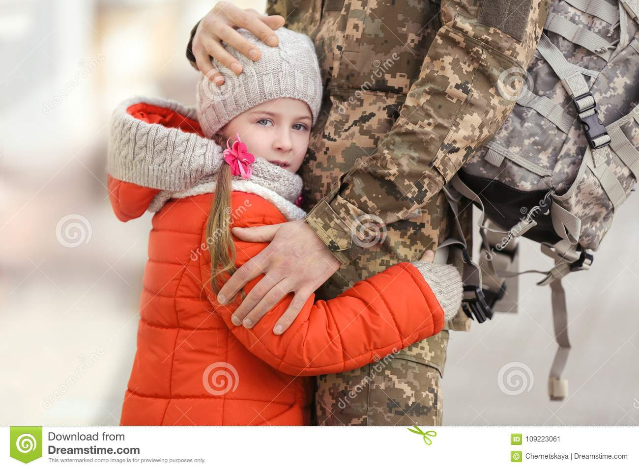 Little girl and her father in military uniform