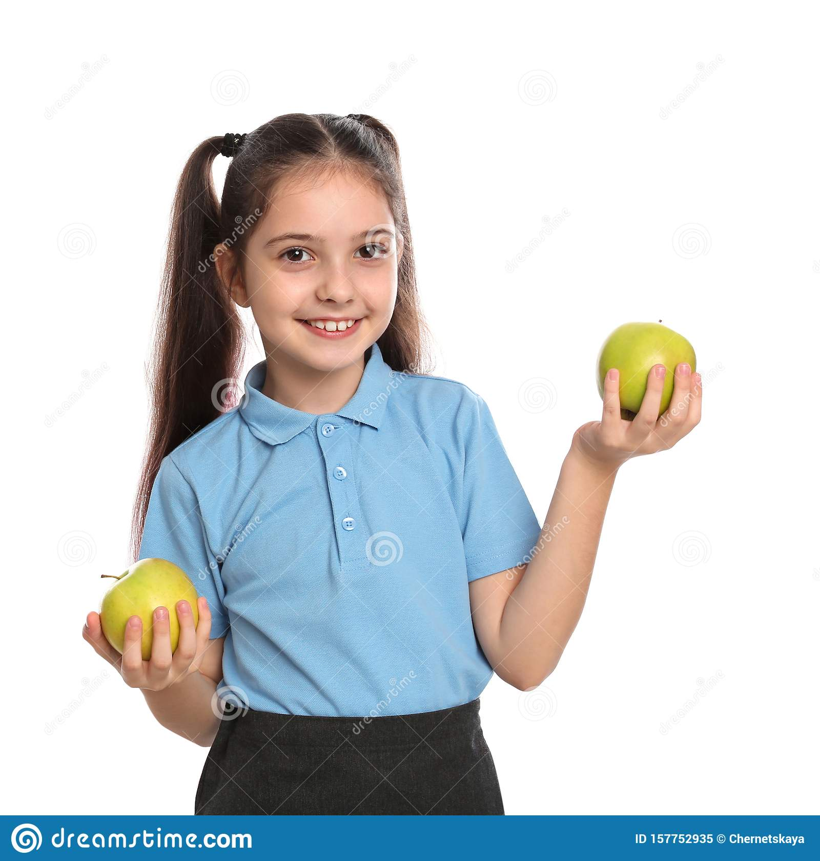 Little girl holding apples on white. Healthy food for school lunch