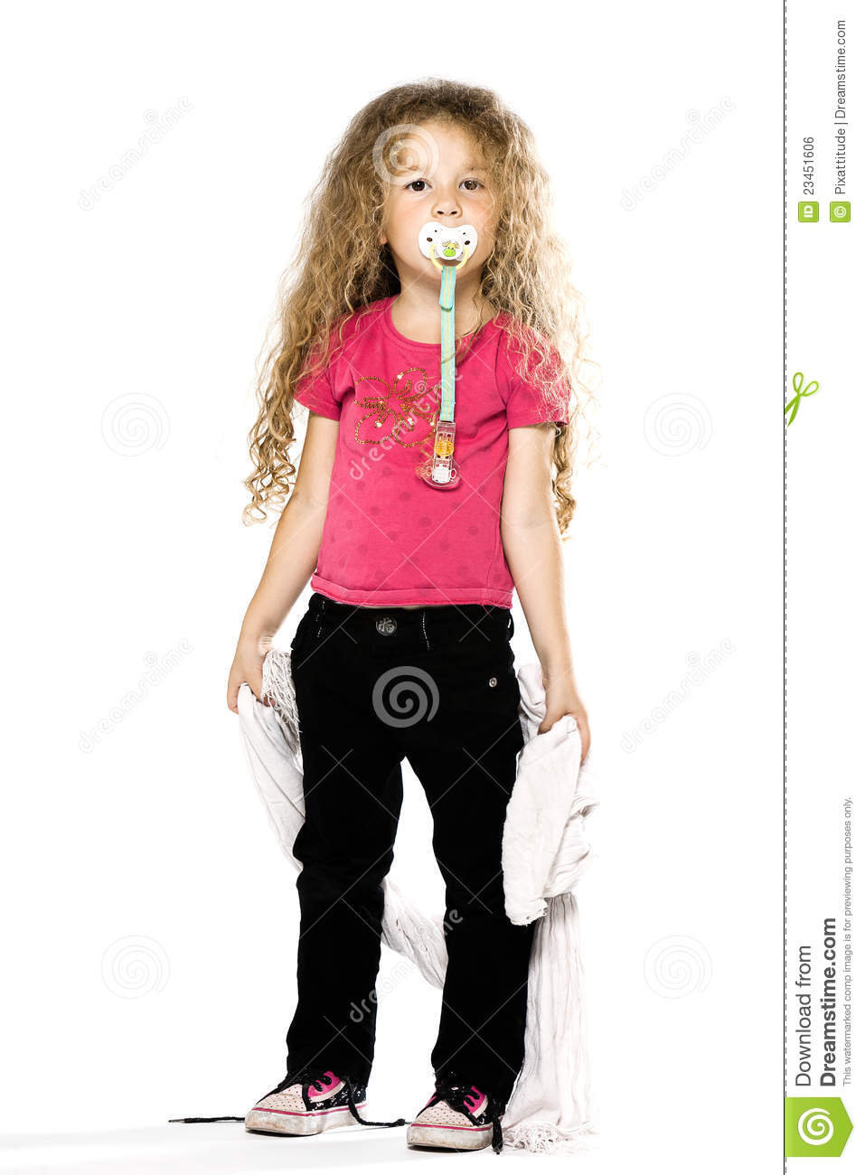 little girl holding blanket with pacifier stock photo image of