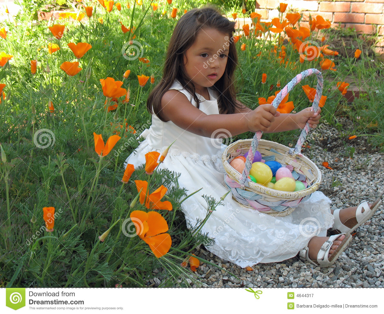 Little girl holding an easter basket full of easte royalty free royalty free stock photo download little girl holding an easter basket negle Image collections