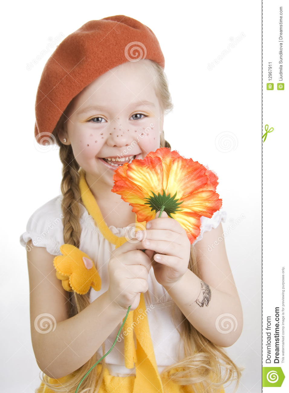Little Girl Holding A Flower And Smile. Stock Image ...