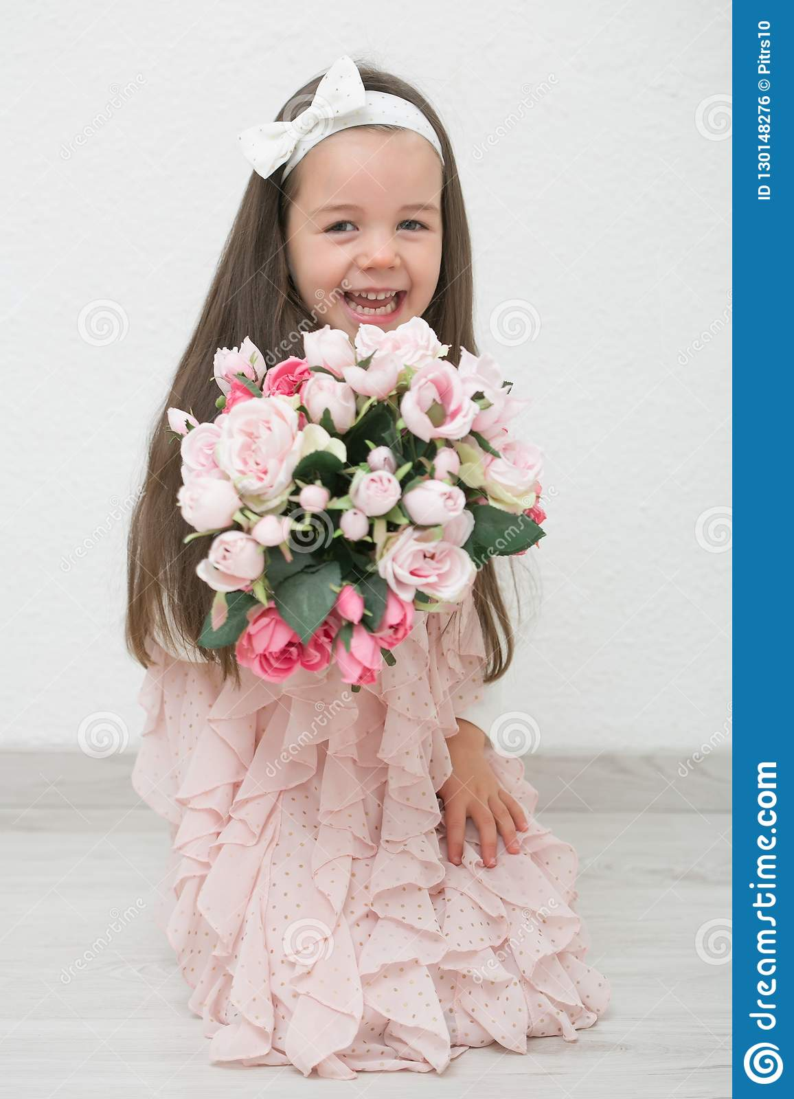 Little Girl Holding Flowers Stock Image - Image of people
