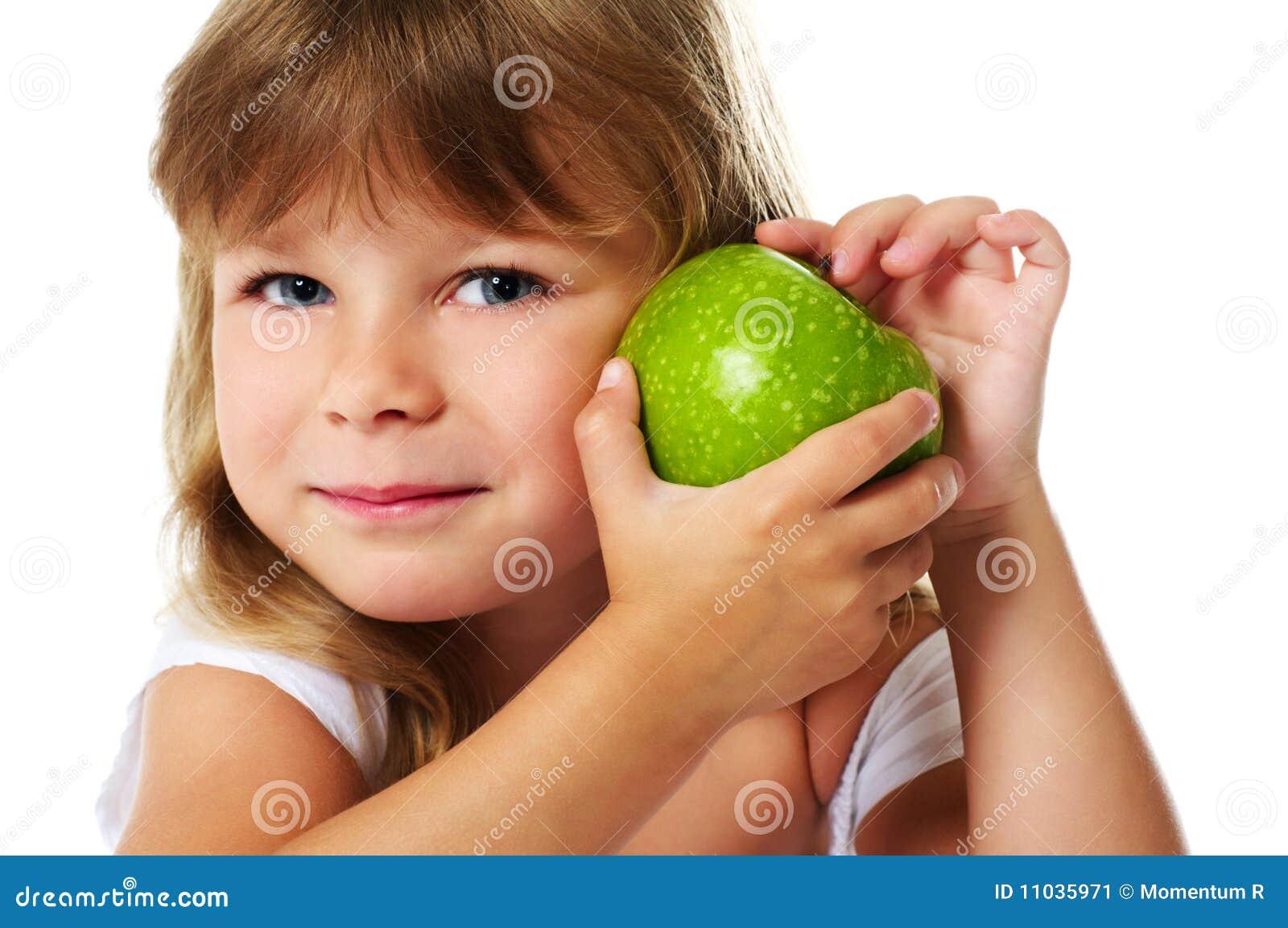 Little girl holding green apple