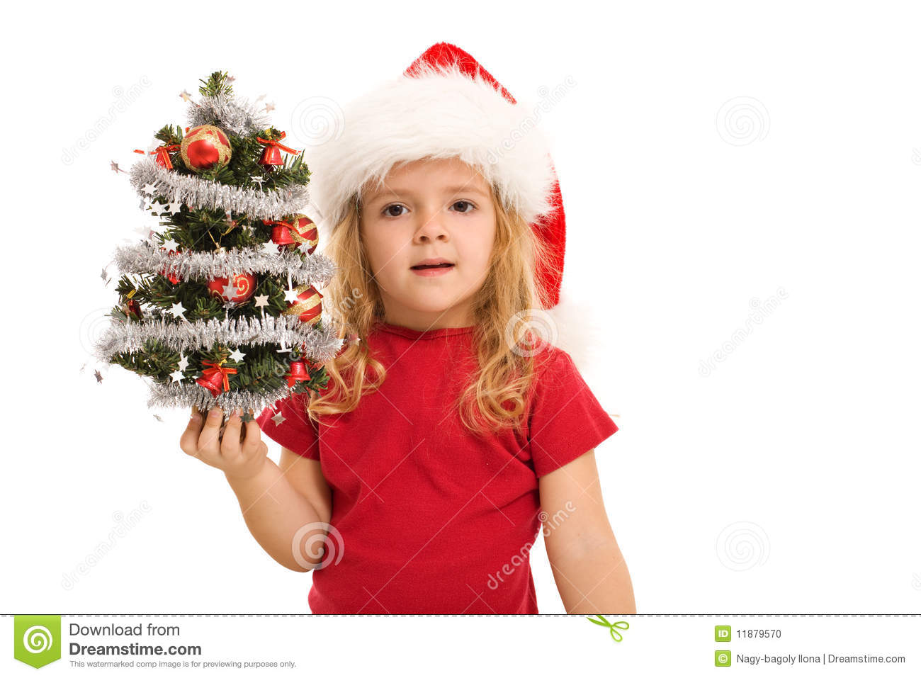 Little Girl Holding Small Decorated Christmas Tree Stock