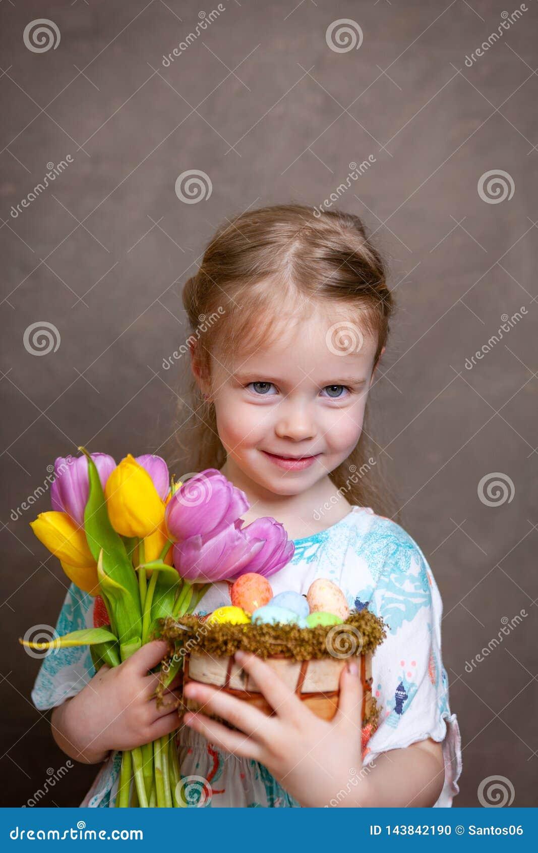 Little girl holding tulips
