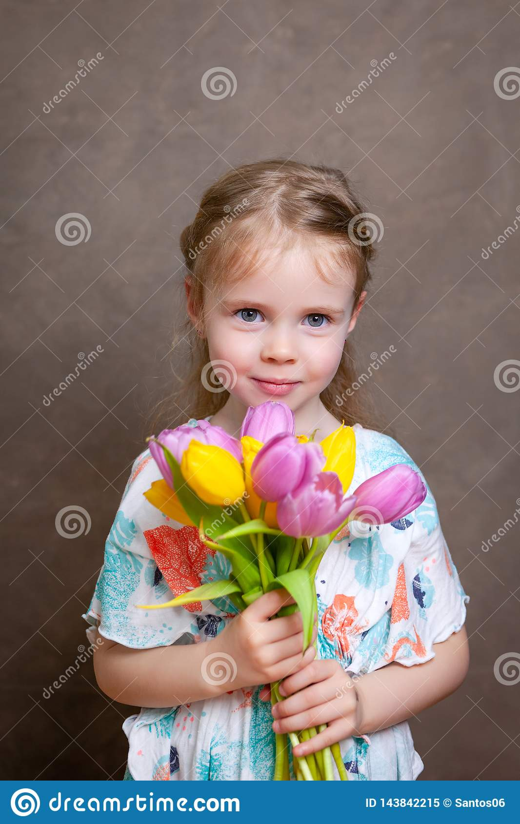 Little girl holding tulips