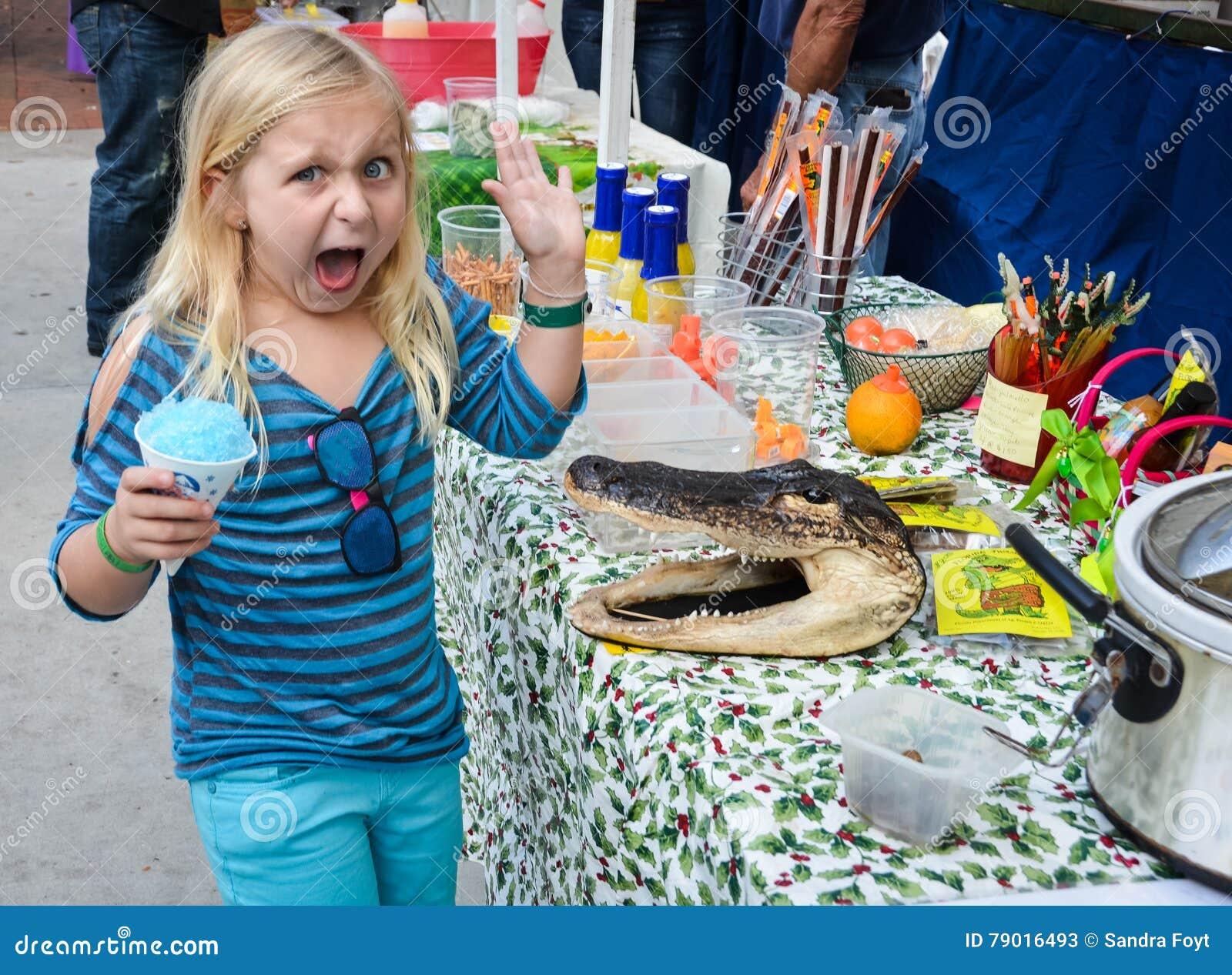 Little Girl Horrified by Alligator