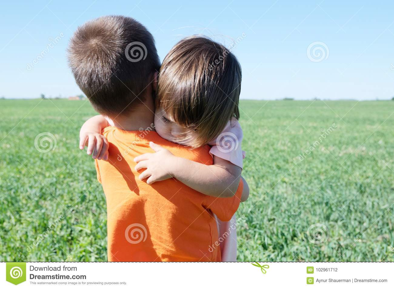 little girl hugging boy happy siblings childhood stock photo
