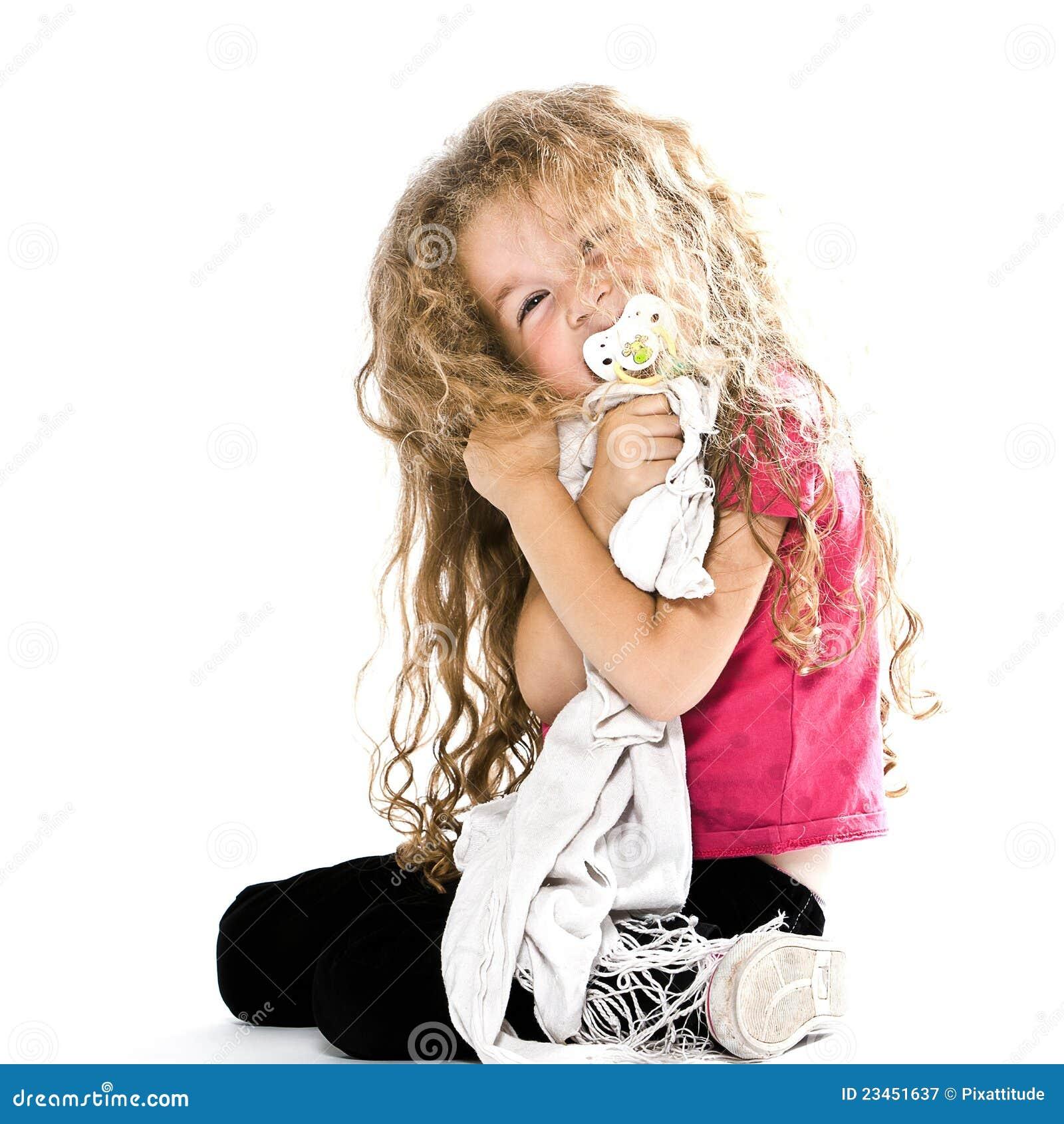 Little Girl Hugging Pacifier Blanket Smiling Stock Image