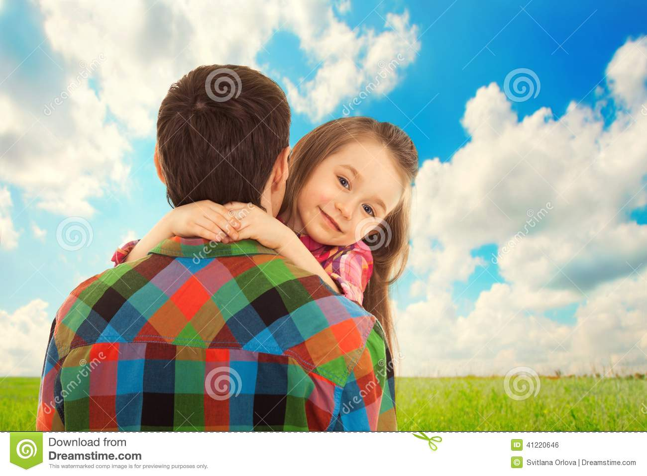 Little Girl hugs her father.