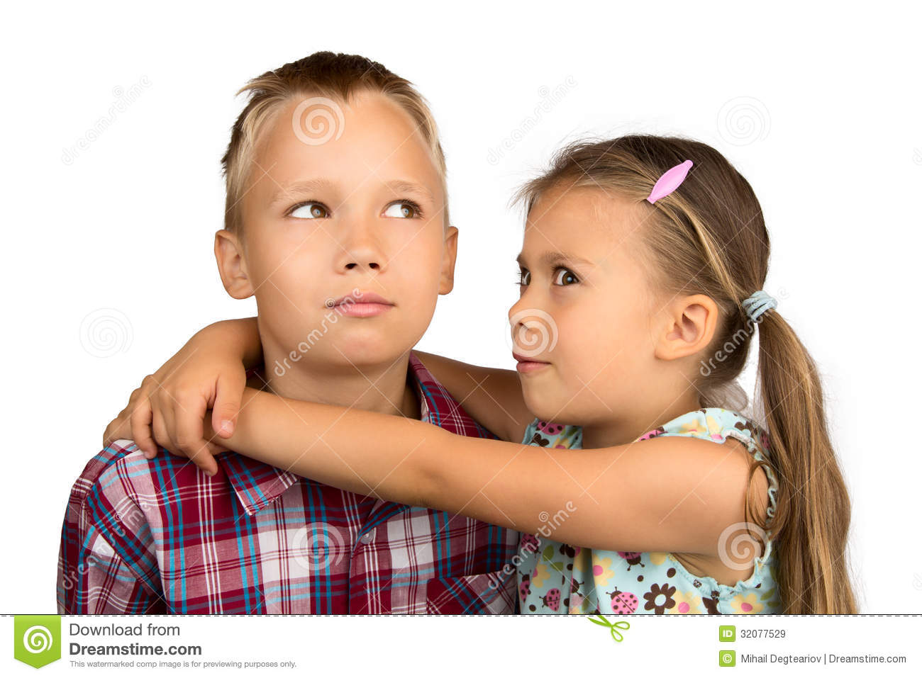 little girl hugs her older brother royalty free stock