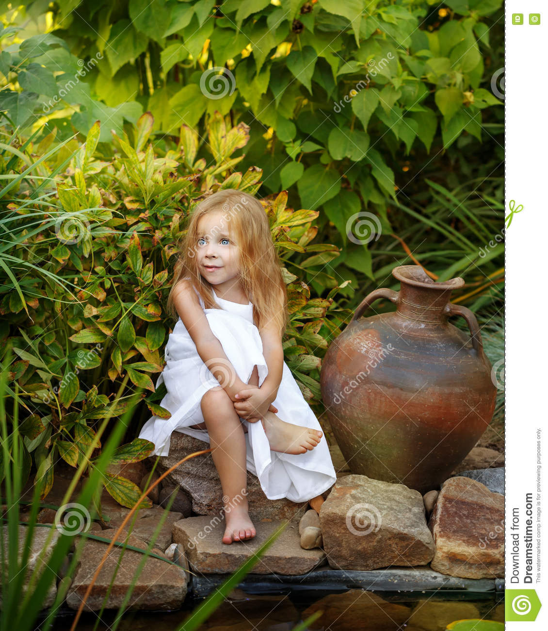 Little girl with a jug