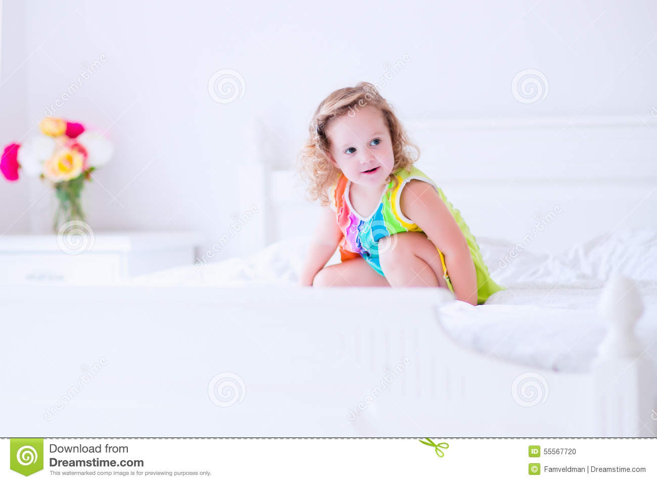 little girl jumping on a bed stock photo image 55567720. Black Bedroom Furniture Sets. Home Design Ideas