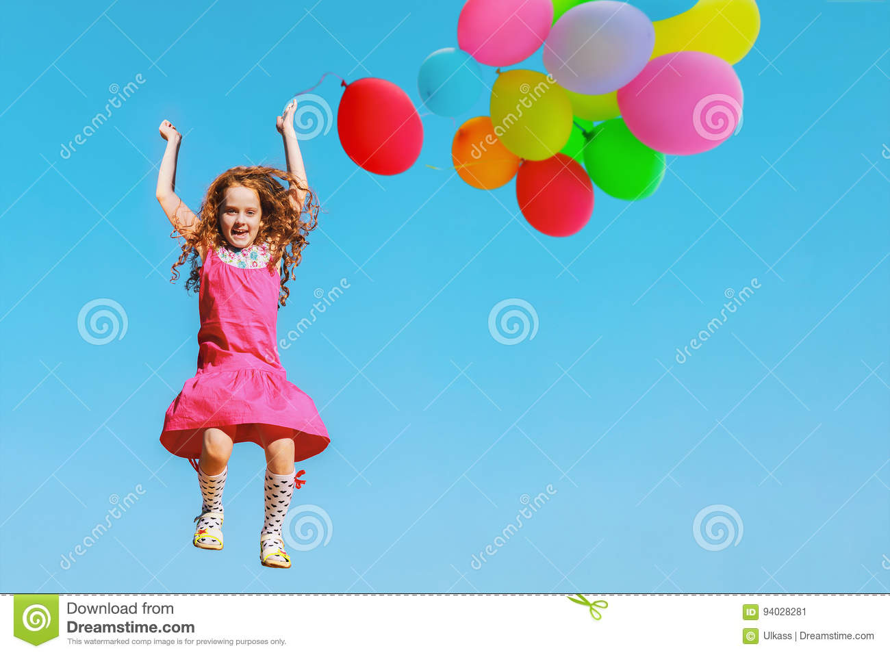 Little girl jumping or dancing in sky background. Healthy lifestyle, freedom, happy childhood concept.