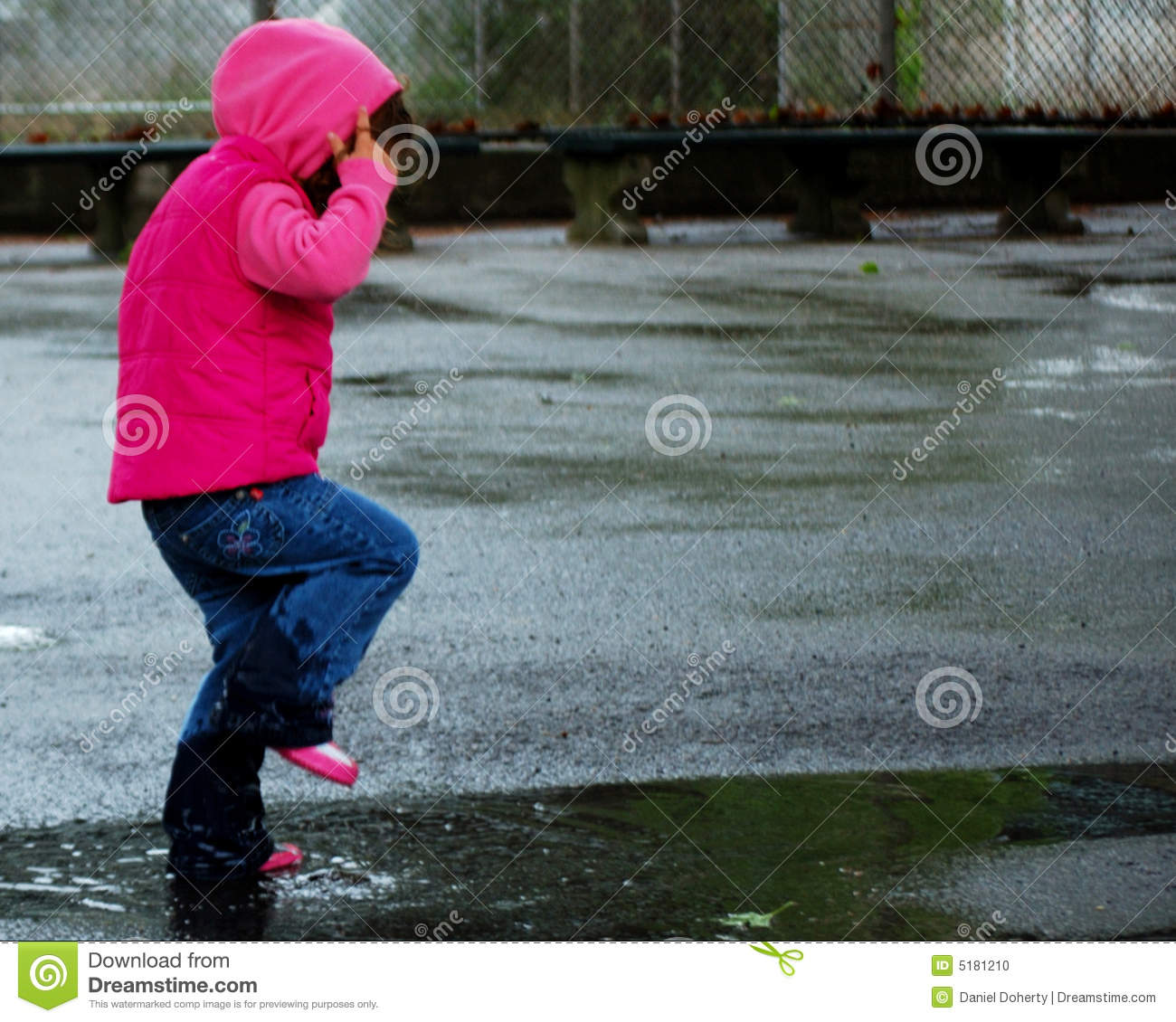 Little Girl Jumping in Puddle 3