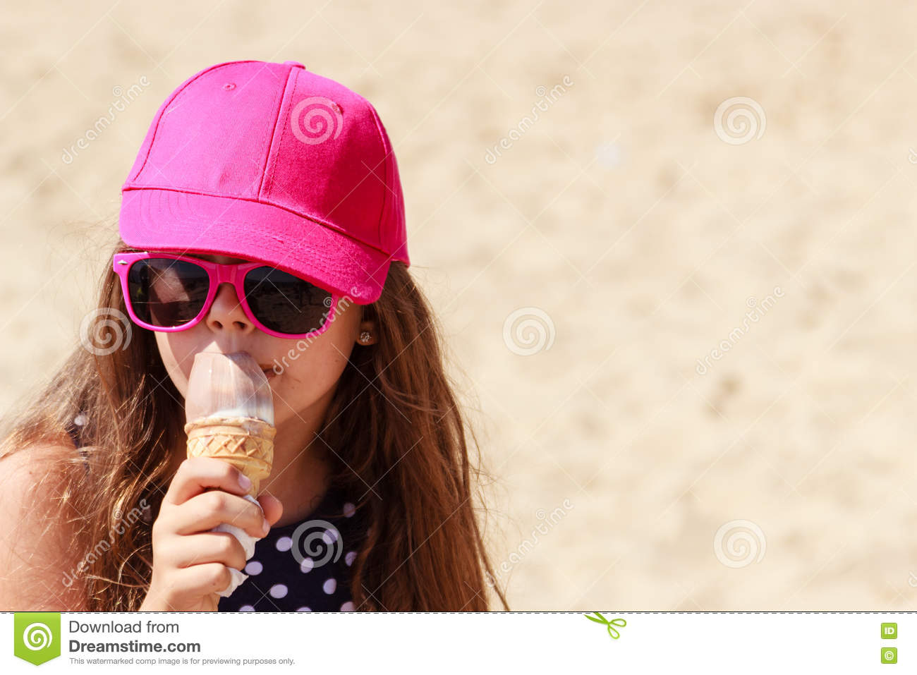 Two Adorable Little Girls Are Eating Ice Cream On The