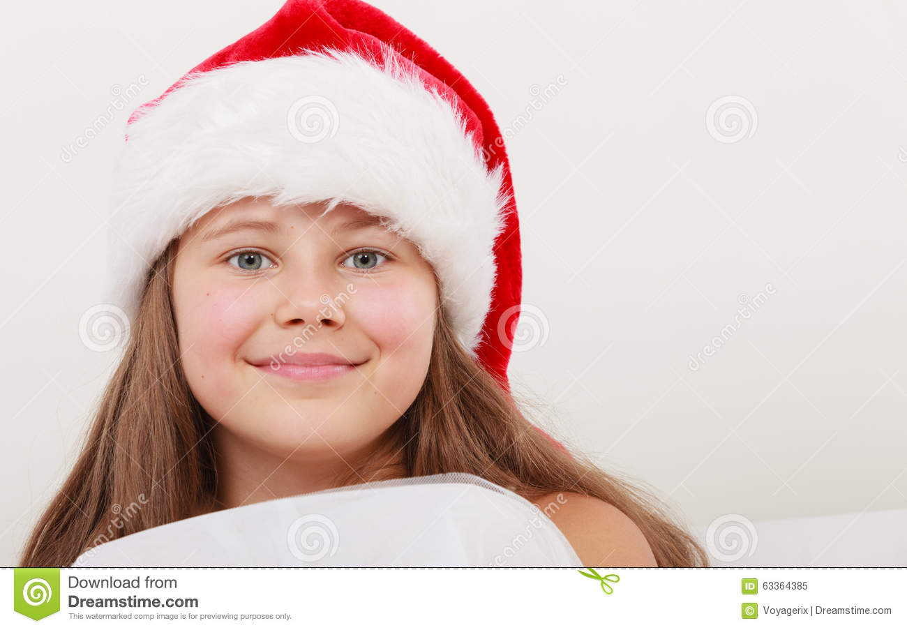 1634f48395b9d Cute little girl kid in red santa claus hat and white dress. Chrtistmas  holiday season.