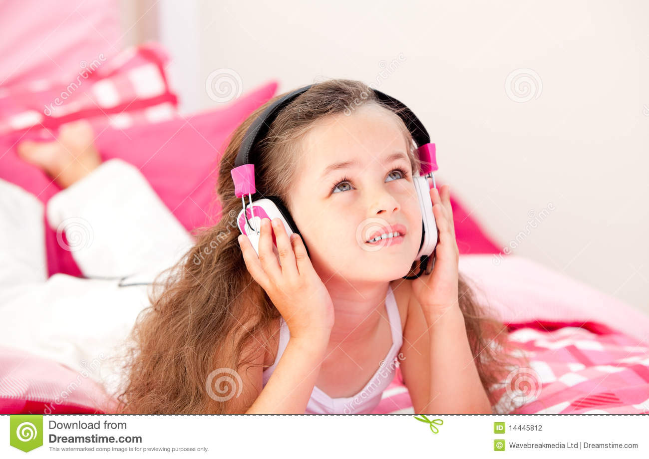 little-girl-listening-music-headphones-14445812.jpg