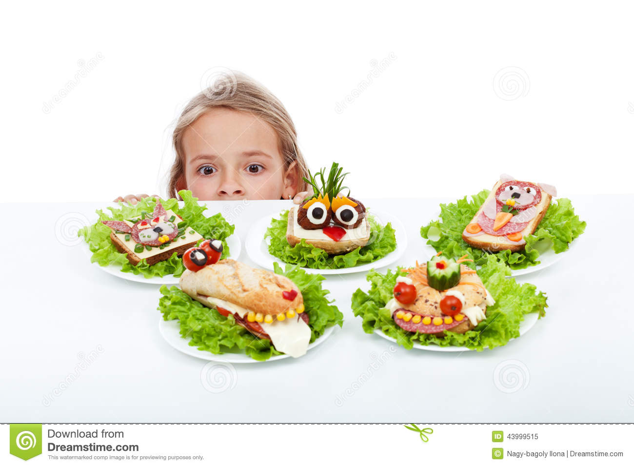Little girl looking at creative food creatures stock photo for Creation cuisine