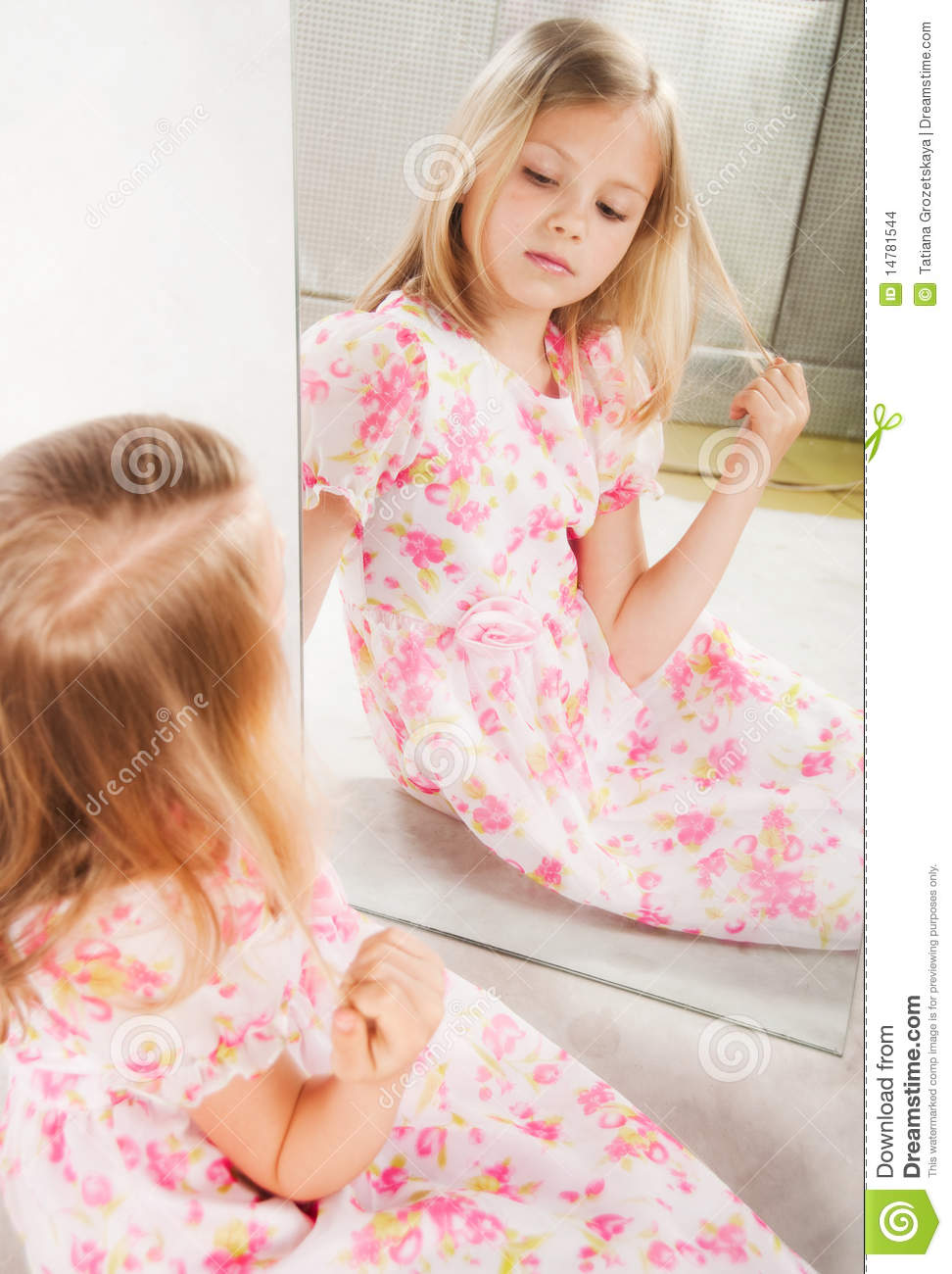 Little girl looking at mirror studio portrait stock for Mirror 7th girl