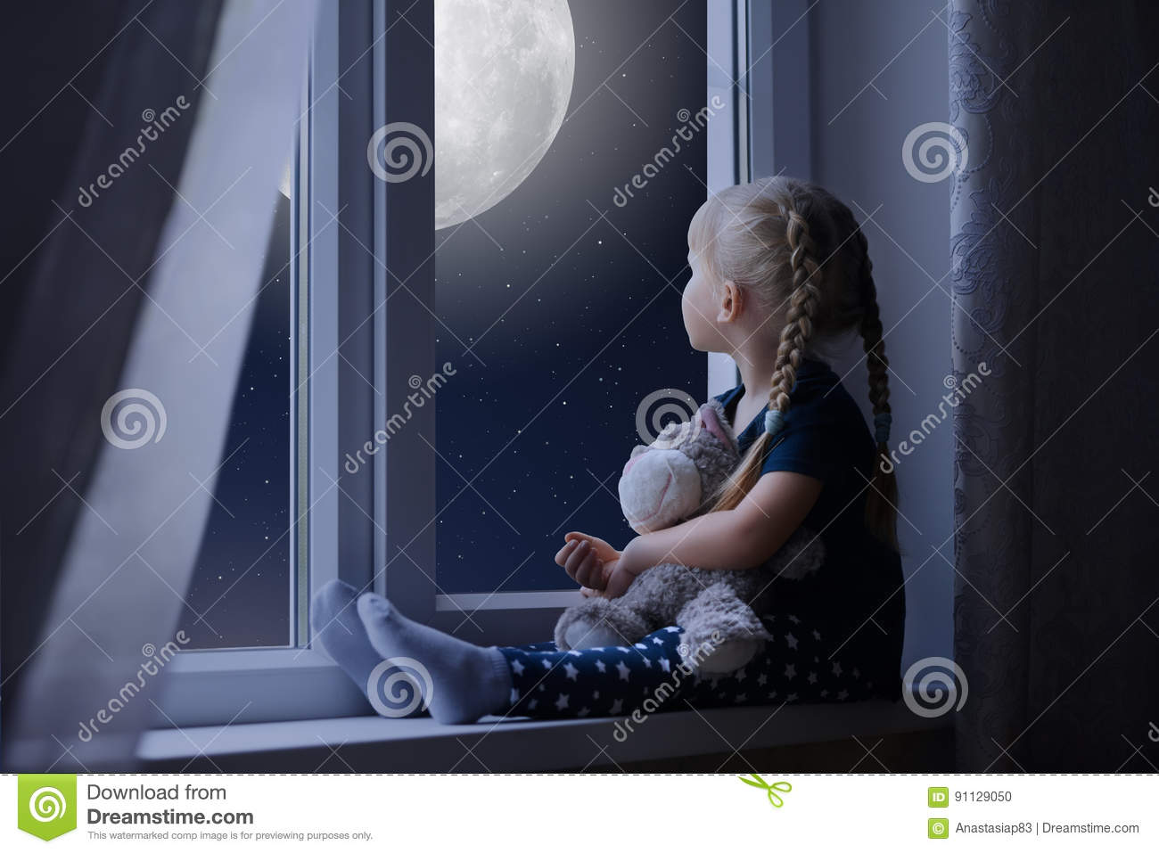 Little girl looking at the starry sky and moon