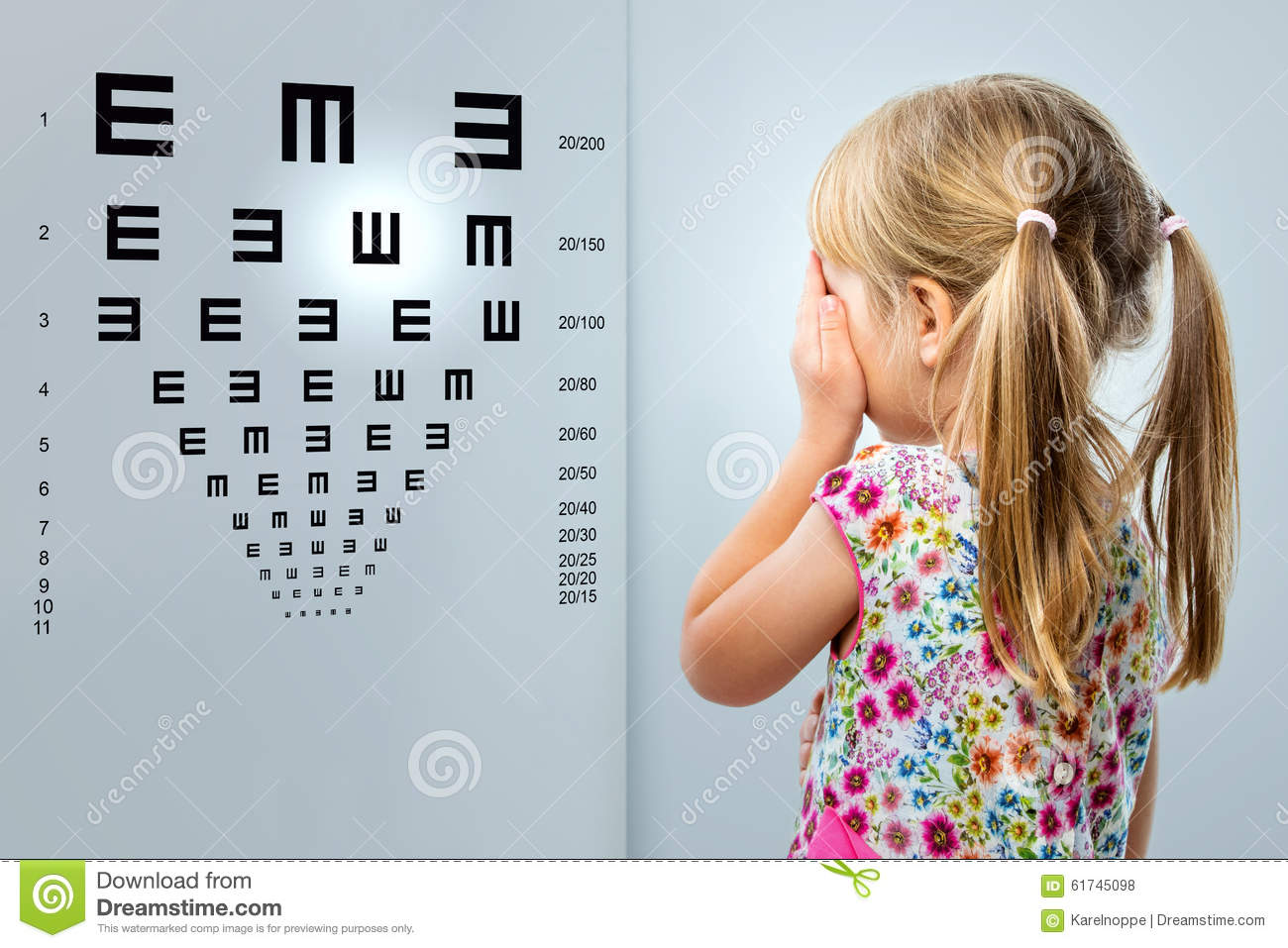 Little girl looking at vision test chart stock photo image of little girl looking at vision test chart geenschuldenfo Image collections