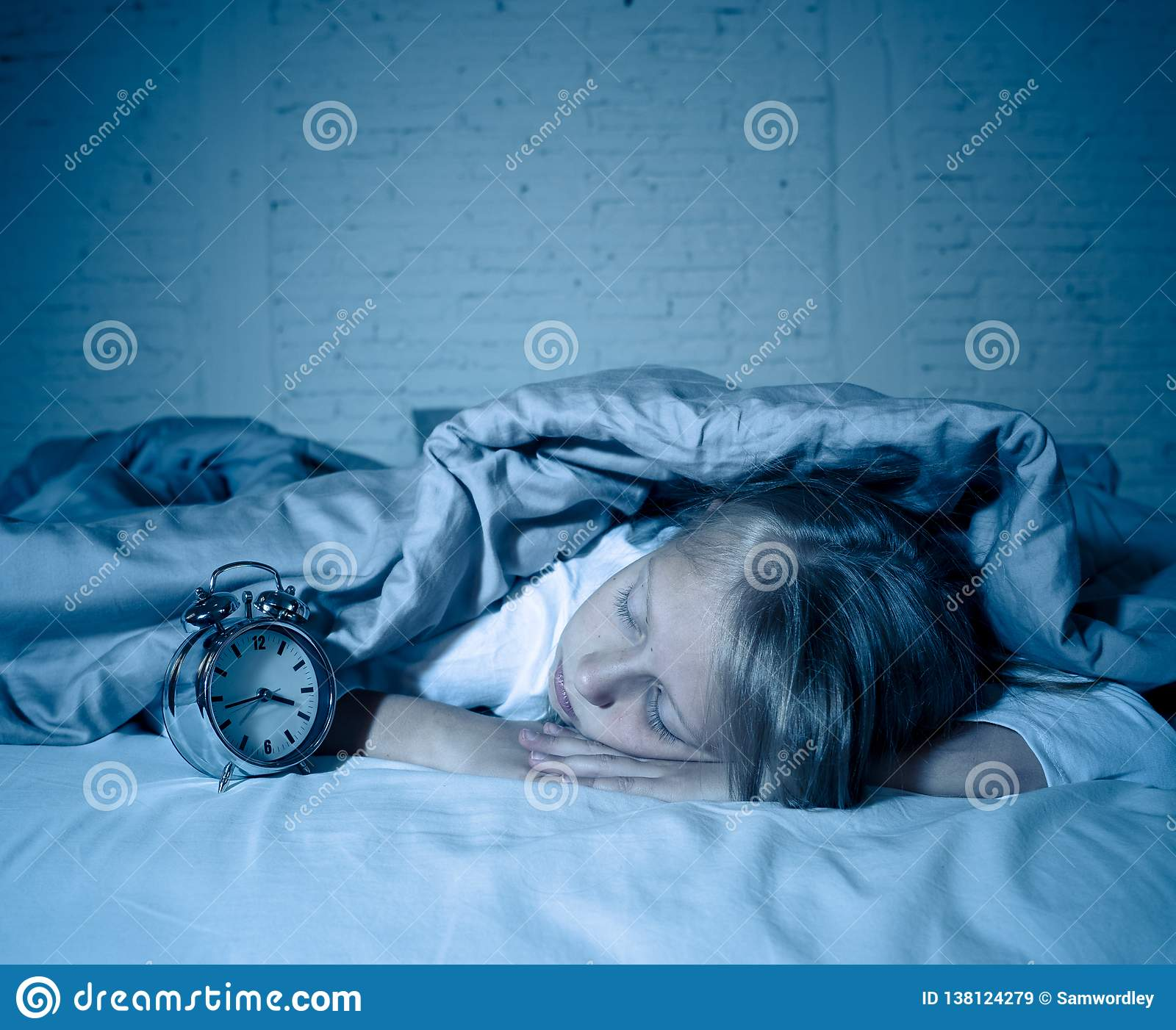 Little girl lying awake in the middle of the night tired and restless suffering sleeping disorders
