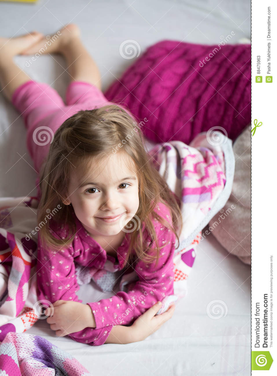 Share little girl sleeping in bed feet with