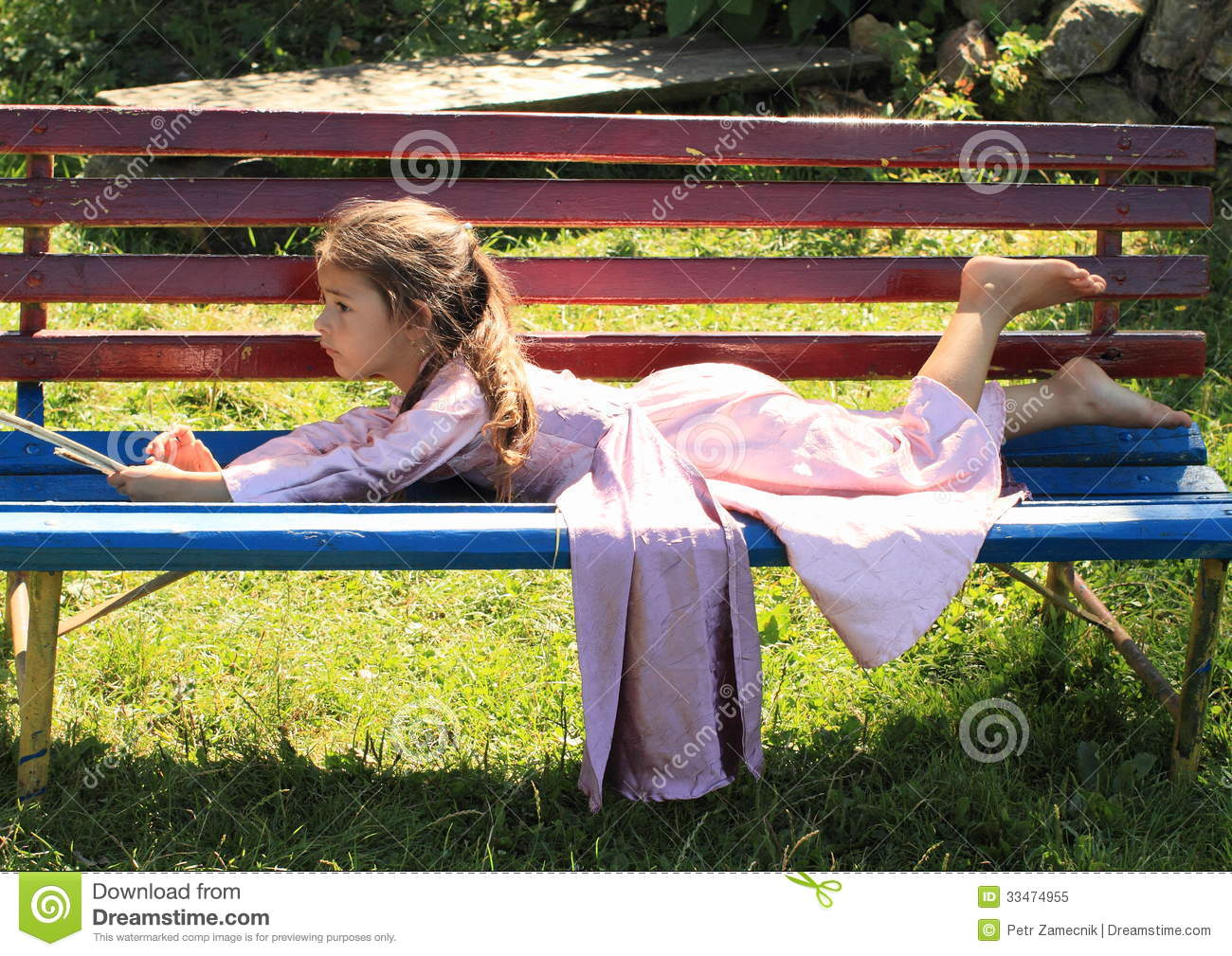 Little Girl Lying On Bench Royalty Free Stock Photo ...