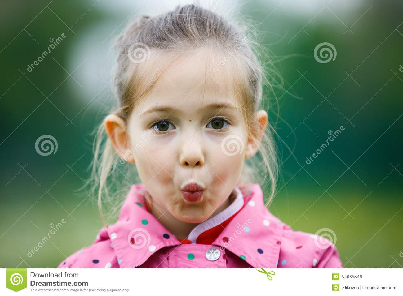 Little girl making faces for the camera stock photo image 54665548
