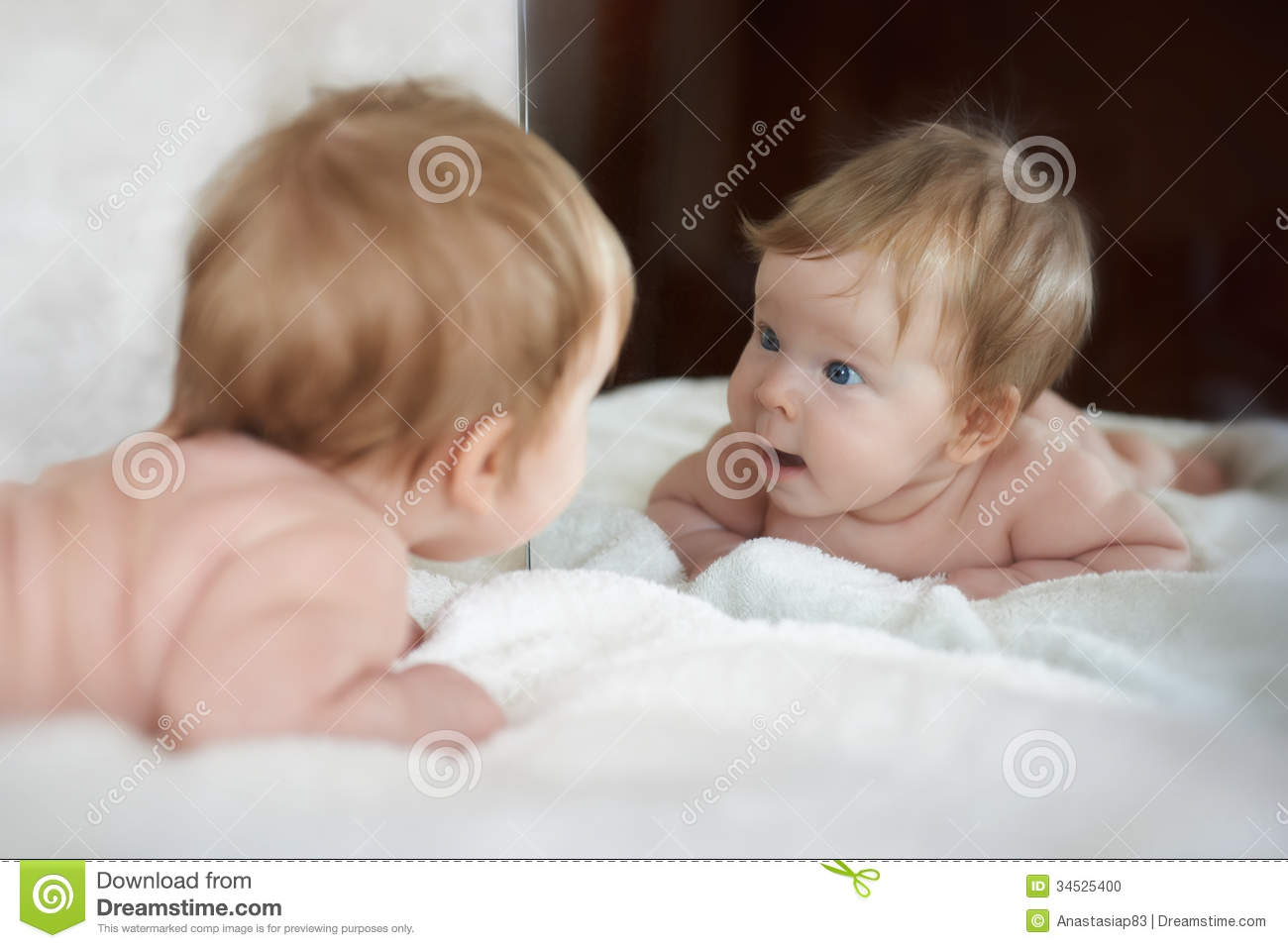Little girl met a new friend in the mirror reflect
