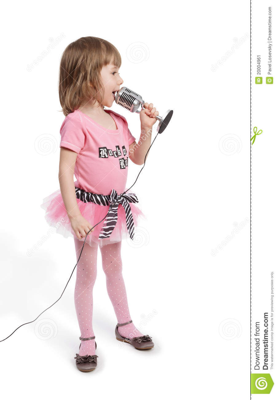 Little girl with microphone stands and sings