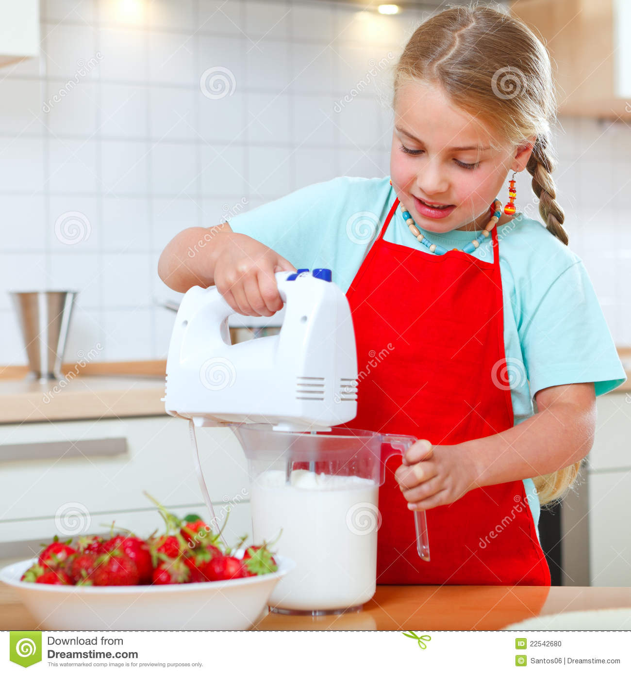 Little Girl With Mixer In Kitchen Stock Photo