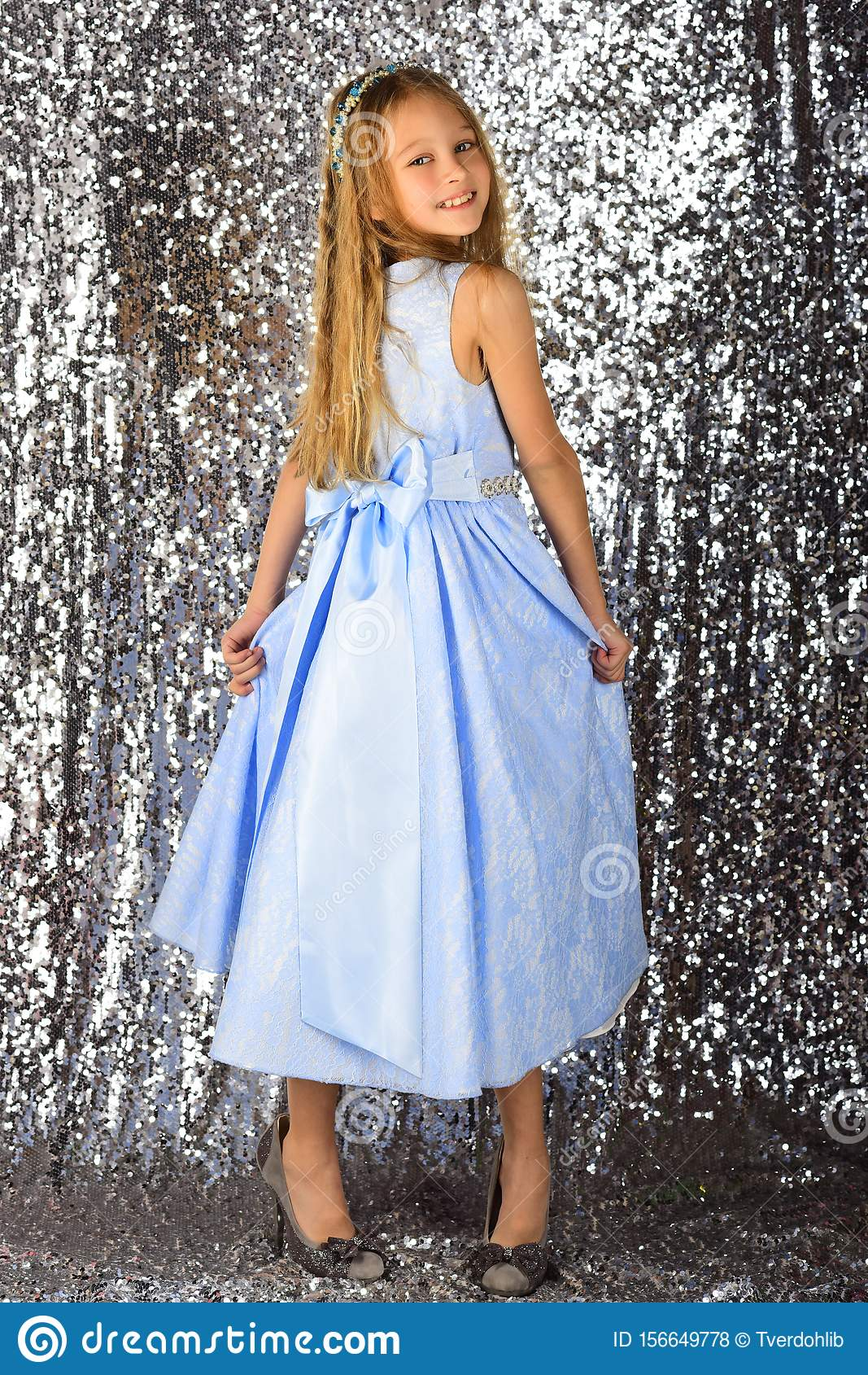 Little girl model, wedding, fashion concept - girl dressed in blue dress smiling
