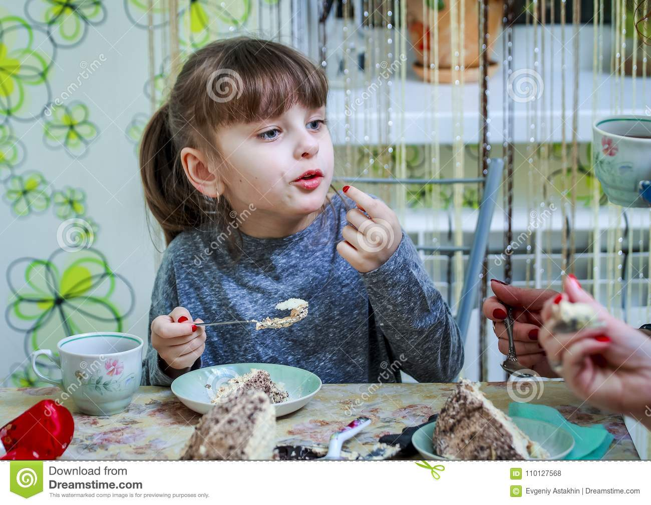 Little Girl And Mom In The Kitchen Drinking Tea And Eating Cake ...