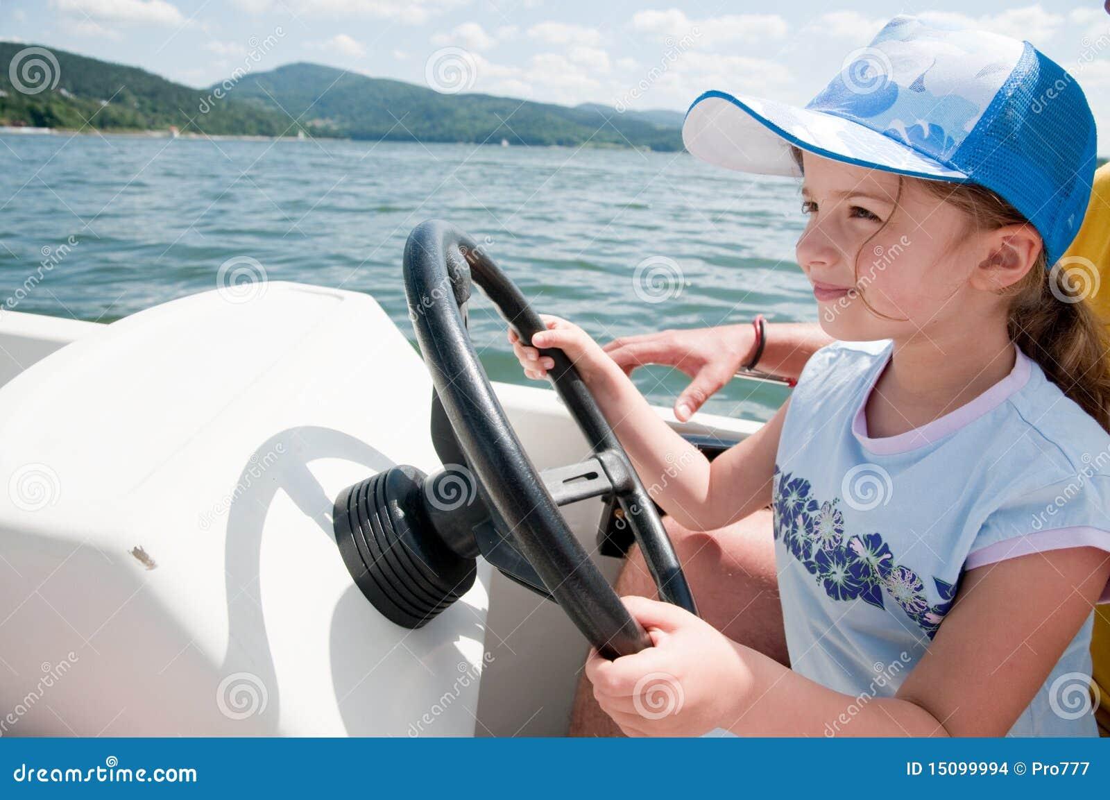 Little girl on motorboat