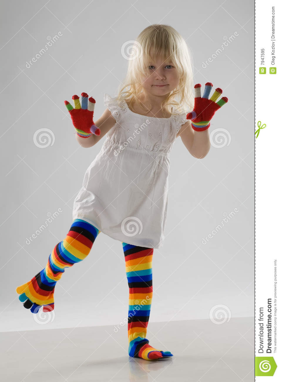 Little girl in multi-coloured clothes